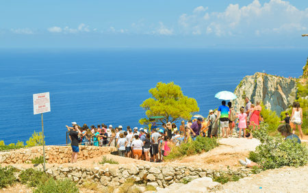 Shipwreck Bay, Zakynthos Island, Greece - July 26, 2017: The queue of tourists on the observation platform, which offers a view of Navagio beach. Editorial