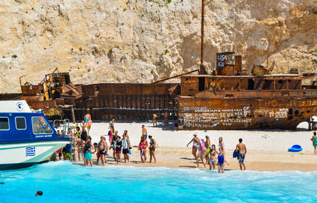 Shipwreck Bay, Zakynthos Island, Greece - July 26, 2017: Tourists on the Shipwreck Beach. Editorial