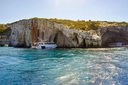 Zakynthos, Greece - July 26, 2017:  Excursion tourist ships near the Blue Caves. Editorial