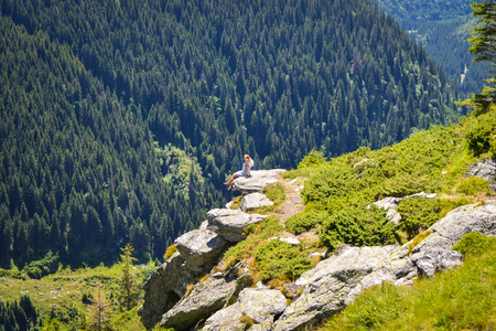 Girl on the cliff edge Transfegerashskoy mountain road.