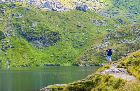 The man near lake Balea, located on the pass of the Transfagarasan road. Romania. Stock Photo