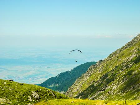 Parasailing in the mountains, near the pass of Transfagarasan road, Romania.