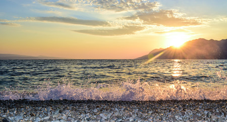 Wonderful sunset on the Punta Rata Beach, Brela, Croatia. Stock Photo