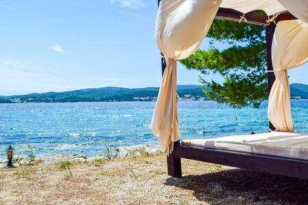 Beach bed with canopy. Orebic, Croatia,