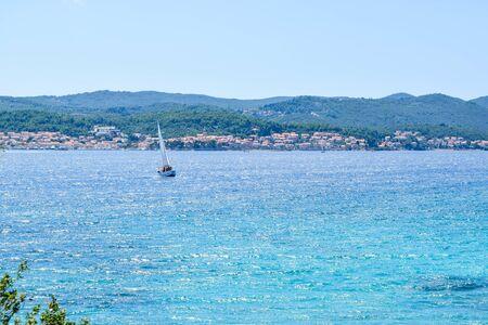Yacht at sea against the Korcula cityscape background, Croatia. Stok Fotoğraf