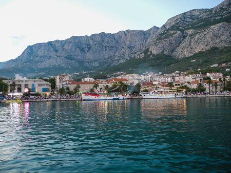 Cityscape of Makarska, Croatia. View of the city from the sea.