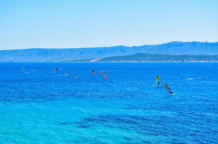 Windsurfer training near Zlatni Rat beach, Brac island, Croatia.. Archivio Fotografico - 134773593