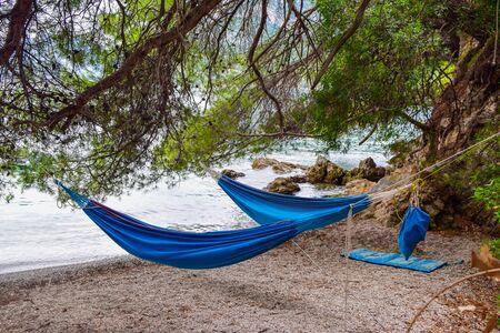 Hammocks for overnight at the beach. Zuljana, Peljesac peninsula, Croatia.
