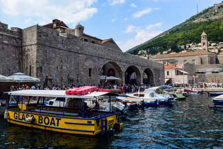 Dubrovnik, Croatia - July 26, 2018: Boats near the walls of the old city of Dubrovnik. Editorial