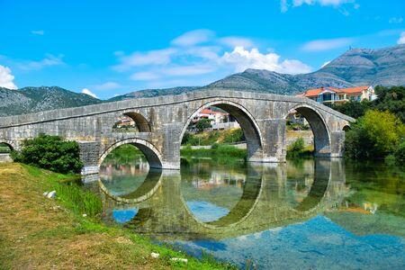 Arslanagic Bridge. View on Trebinje River. Bosnia and Herzegovina. 写真素材 - 134774714