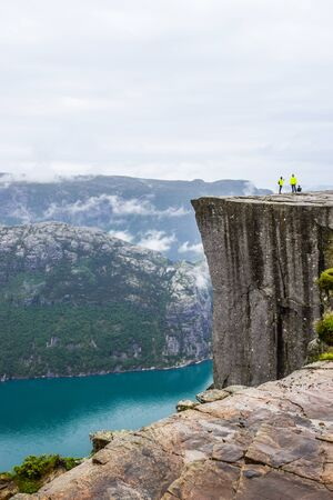 Pulpit Rock, Norway - June 19, 2019: Tourists on Prekestolen on a cloudy summer day.