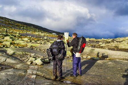 Tourists walk along the trail to Trolltunga, Norway.