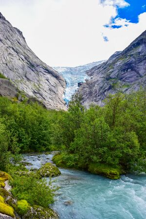 The Brikdalsbreen glacier, which is the sleeve of the large Jostedalsbreen glacier in Norway. The melting glacier forms the lake with clear water. 写真素材
