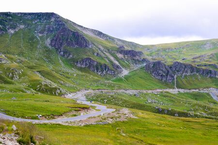 Landscape from Transalpina serpentines road DN67C. This is one of the most beautiful alpine routes in Romania and the highest mountain asphalt road in Romania and the Carpathians mountains.