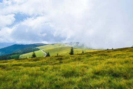Fog and low clouds over the Transalpina serpentines road DN67C. This is one of the most beautiful alpine routes in Romania and the highest mountain asphalt road in Romania and Carpathians mountains.