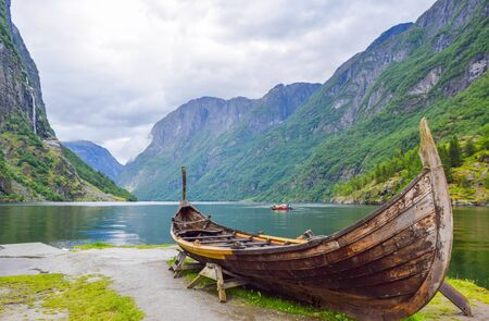 Viking boat on the coast of the Nereyfjord, Gudvangen. Located is near Viking village Njardarheimr in Gudvangen. Norway.