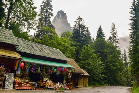 Souvenir shops on the Bicaz Gorge road in Romania, is one of the most spectacular drives in country, location in Carpathian mountain. The high cliffs of gorge are divided by the mountain river Bicaz.