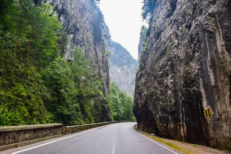 Bicaz Gorge road in Romania, is one of the most spectacular drives in the country, location in Carpathian mountain. The high cliffs of the gorge are divided by the mountain river Bicaz.