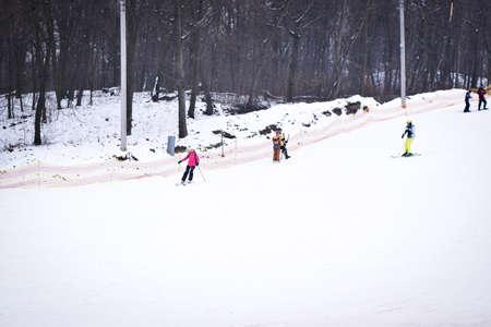 Kiev, Ukraine - February 18, 2018: Skiers on a snowy hill. Winter fun. Skiing on the ski slope.