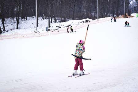 Kiev, Ukraine - February 18, 2018: Skiers on a snow slide with a ski lift. Winter fun. Skiing on the ski slope.