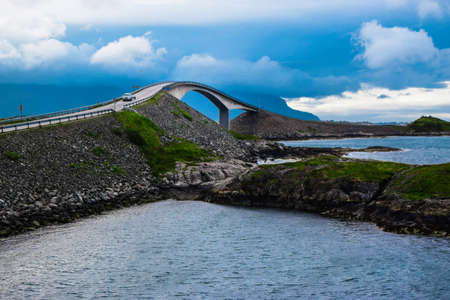 Storseisundet Bridge (Storseisundbrua) is the most famous and longest of the eight bridges that make up Atlantic Ocean Road. It is one of the country's official national tourist routes of Norway. 免版税图像