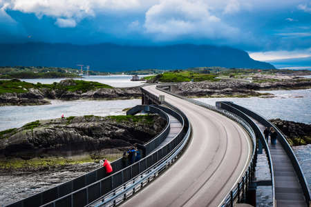 Atlantic Ocean Road, passing through the several small islands in Norwegian Sea and is part of National Tourist Routes of Norway. One of most famous landmarks. Beautiful blue cloudy summer landscape.