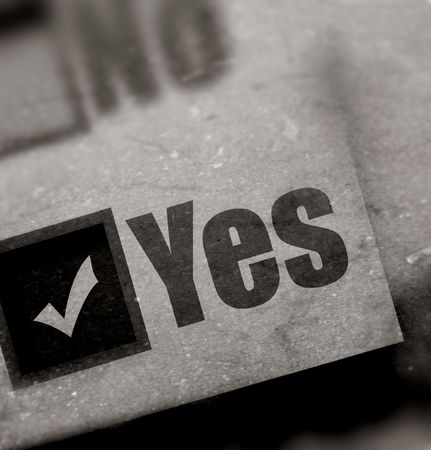 thumbtacked: Paper sheet with YES word Stock Photo