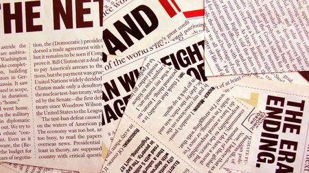Close up of new paper headlines