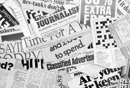 happenings: Close up of new paper headlines