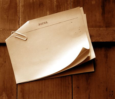Writing old note paper on wood background Stock Photo - 3431452