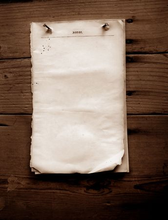 Writing old note paper on wood background Stock Photo - 3439816