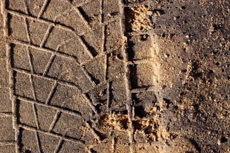 Dirt background with vehicle pattern track Stock Photo - 4728917