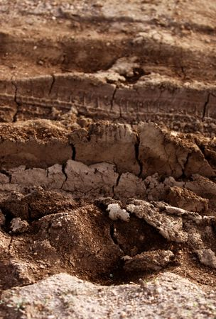 Dirt background with vehicle pattern track Stock Photo - 4772514