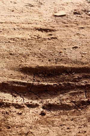 Dirt background with vehicle pattern track Stock Photo - 4772368