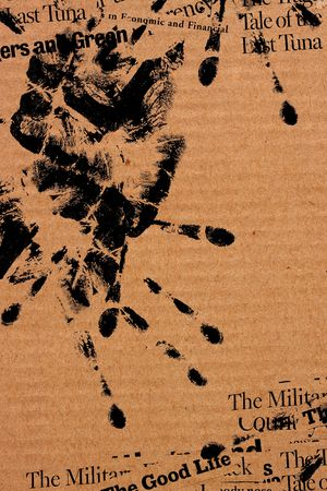 paperboard: Paper with human hand print and abstract text