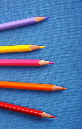 aligned: Multicolored pencils with handmade paper Stock Photo