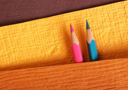 Multicolored pencils with handmade paper Stock Photo - 5004896