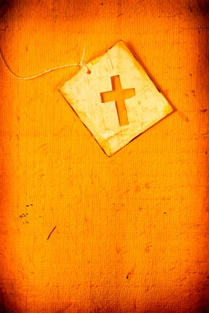 Close up of handmade paper tag with holy cross Stockfoto