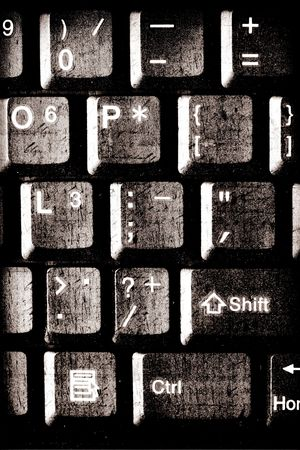 Close up of grunge rusty computer keys photo