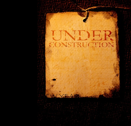 Under construction with  grunge  background photo