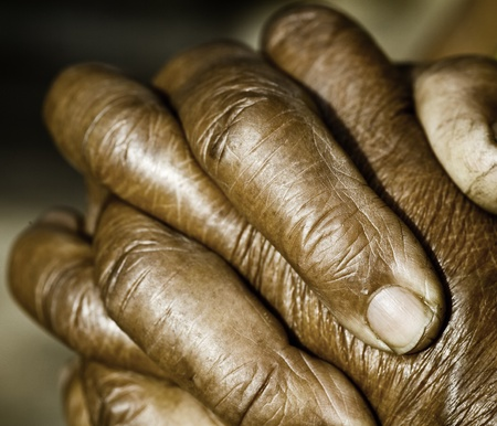 gospel: Close up of Praying Hands Stock Photo