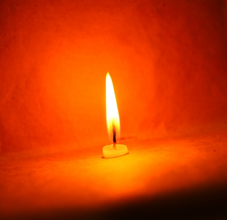 Close up of Candle with red background Stock Photo - 21514493