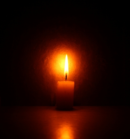 Close up of Candle with red background Stock Photo - 21514525