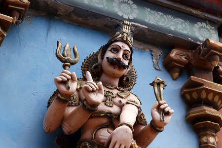 Hindu God Statue with carvings on it photo