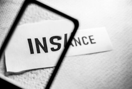 Close up of insurance tag label on paper