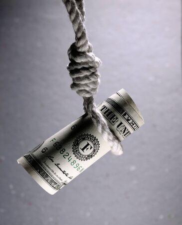 Disparo sobre la disminución del valor monetario y el riesgo financiero Foto de archivo