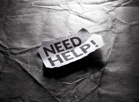 Close up shot of Need Help tag Stockfoto - 126585912