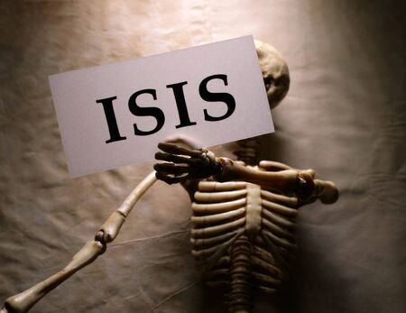 Close up of skeleton holding ISIS label