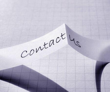 Close up of contact us tag