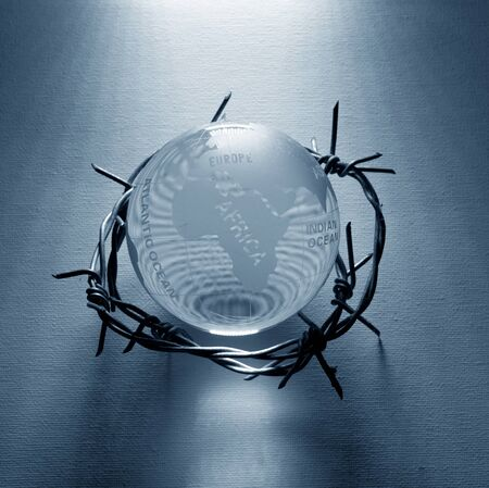 Globe and barbwire depicting global problems and crisis